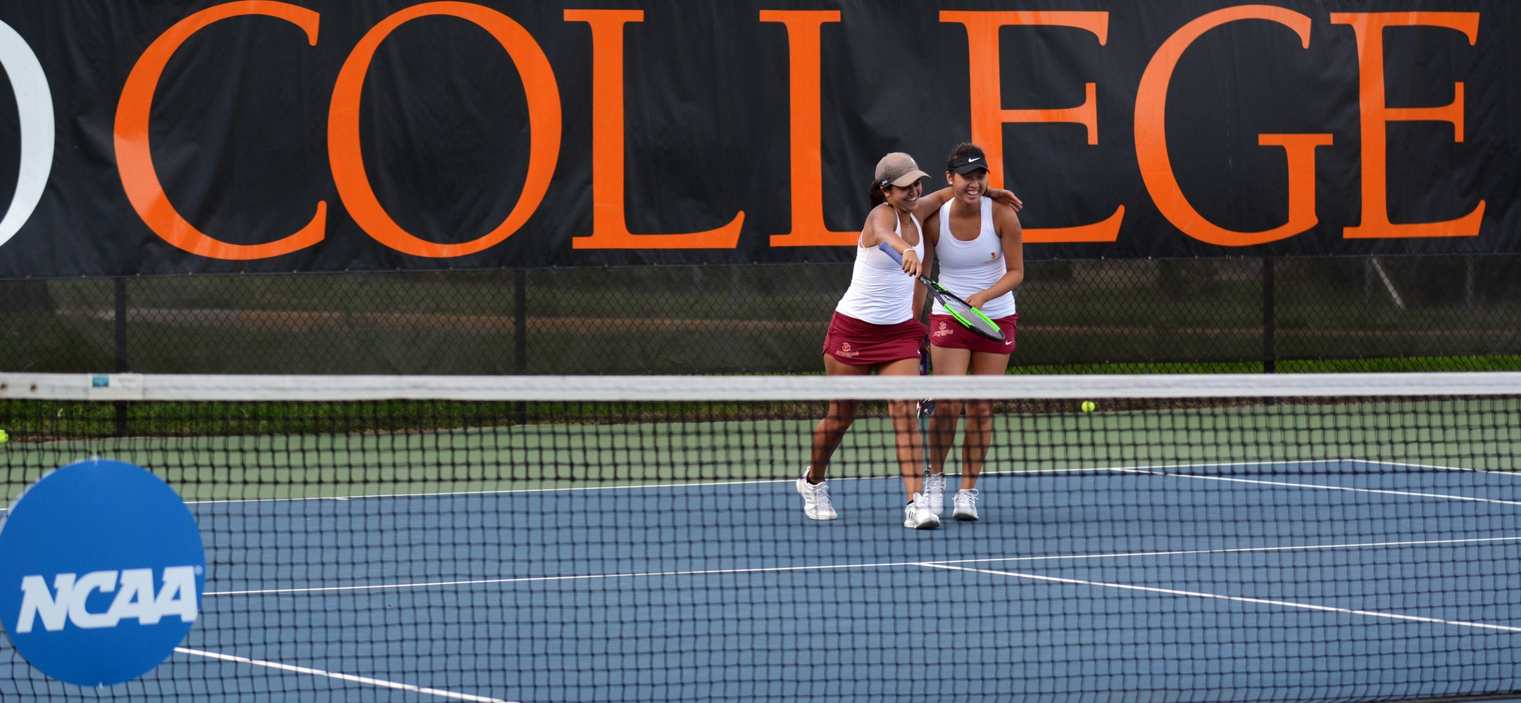 Sarah Bahsoun and Nicole Tan celebrate their three-set win in the NCAA Doubles Quarterfinals