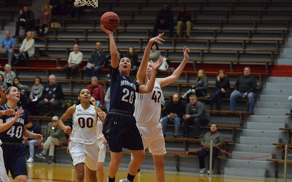 Senior Caitlin Flanagan drives to the basket for a lay-up at Muhlenberg College.