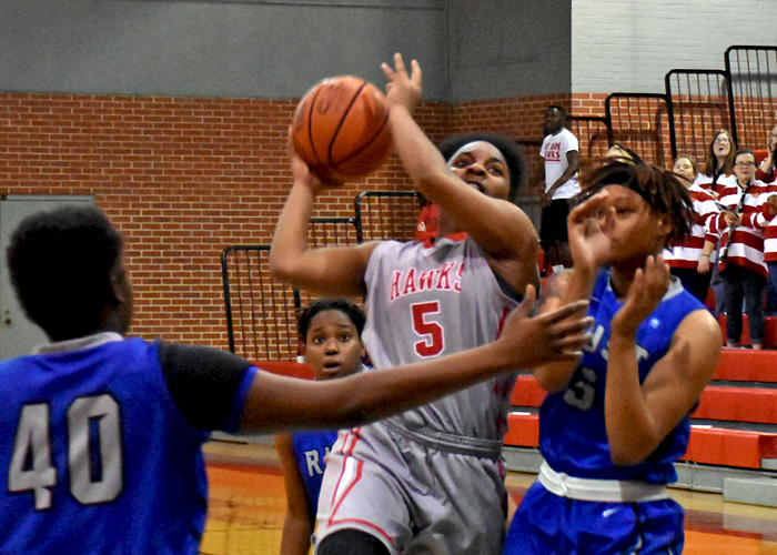 Maia Hill drives to the basket for two of her 19 points in Wednesday's win over Rust College.