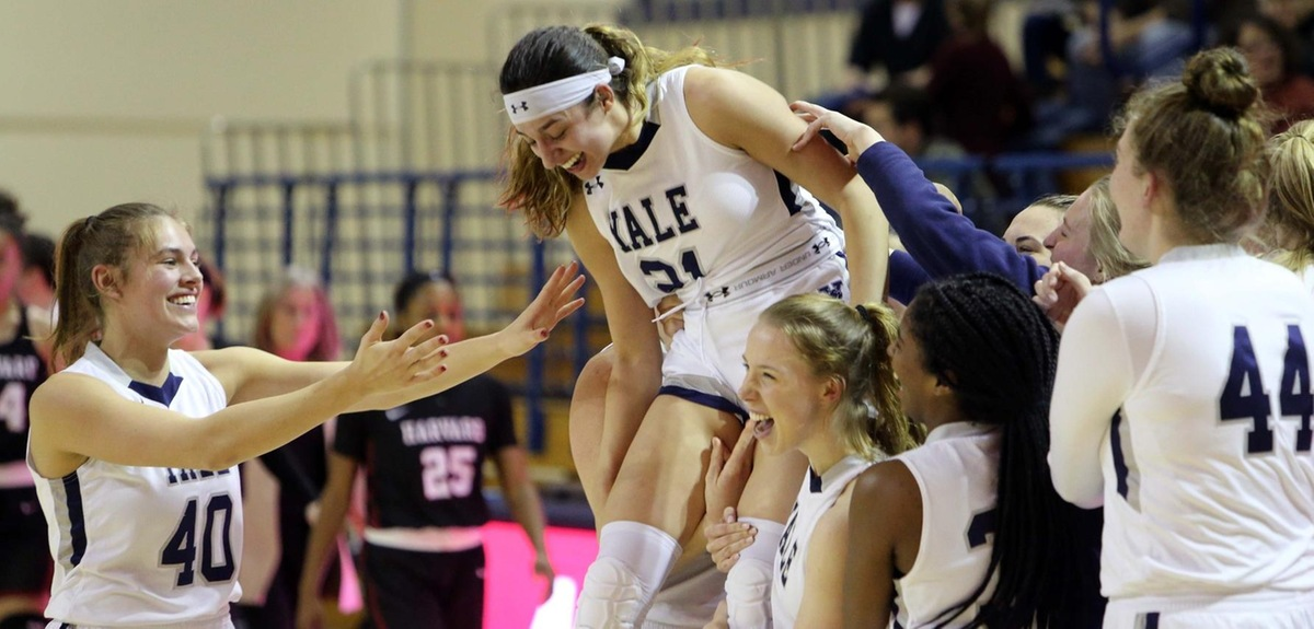 The Bulldogs lift up Roxy Barahman in celebration of her game-winning buzzer beater. (photo by Sam Rubin '95, Yale Sports Publicity)