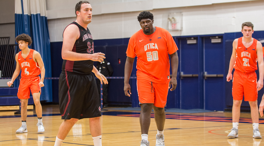 Men's Basketball Downed by Utica