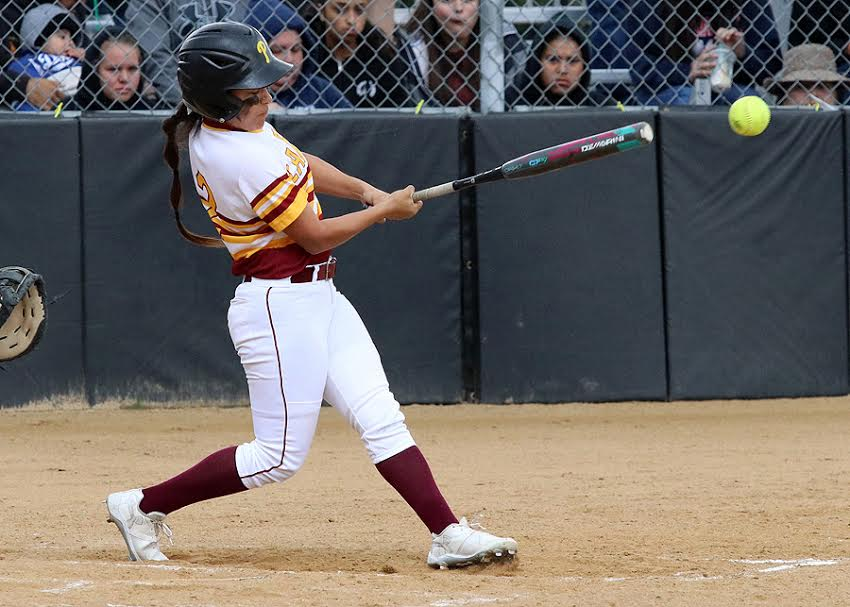 Catcher Jeneve Medrano, batting here, has been a steady performer behind the plate to help PCC to a 13-7 record thus far, photo by Richard Quinton.