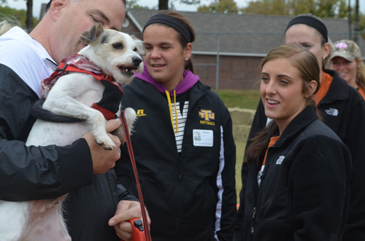 Softball team makes tails wag at Bark in the Park