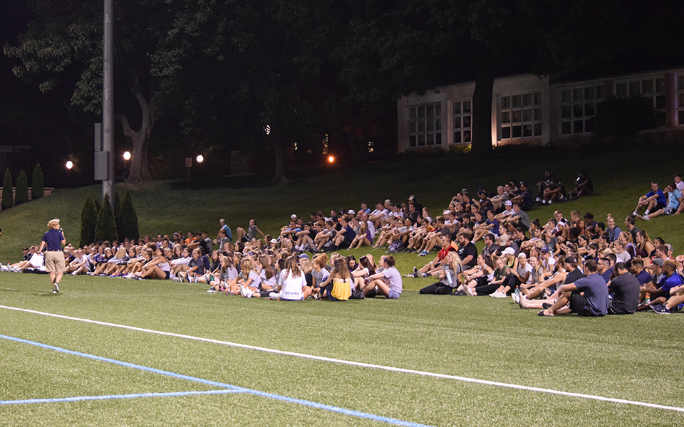 Director of Athletics & Recreation and Head Women's Basketball Coach addresses Moravian's student-athletes during the 2018-19 SAAC Kickoff event in August 2018 on John Makuvek Field.