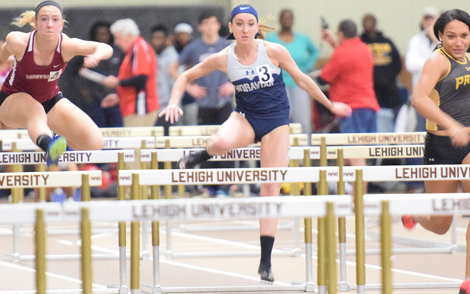 Senior Anna Osman runs a hurdle race during the Leigh University Fast Times Before Finals at Rauch Fieldhouse in December.