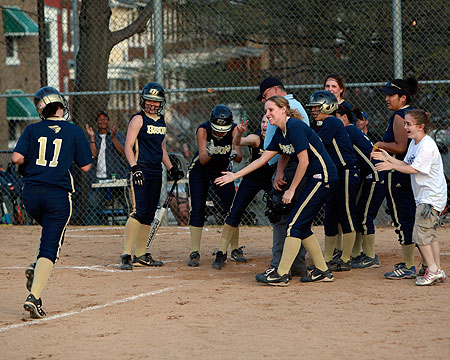 Alicia Balzer runs home towards her teammates after her second home run on Friday.