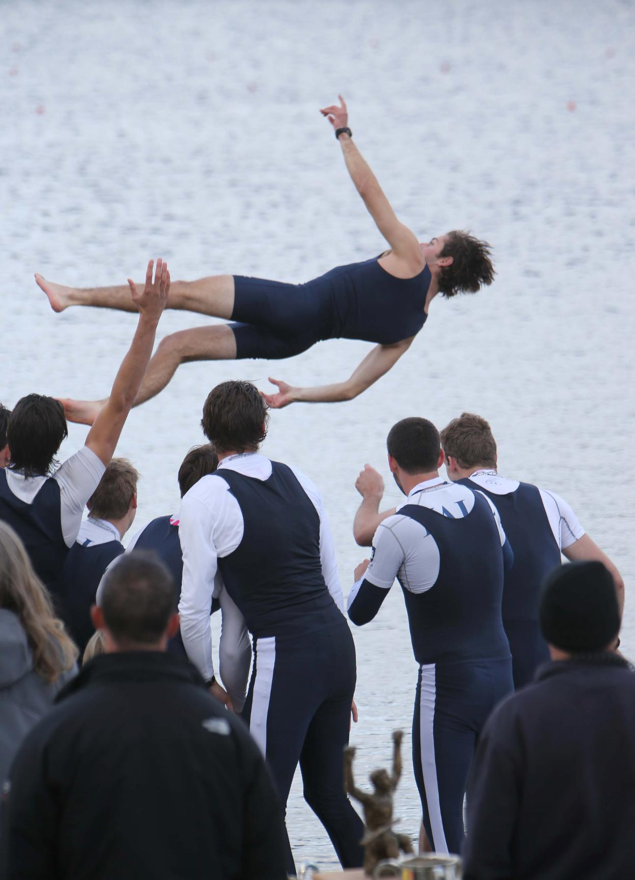 Yale's first varsity eight celebrates by tossing coxswain Chris Carothers into Lake Quinsigamond. (photo by Sam Rubin '95, Yale Sports Publicity)