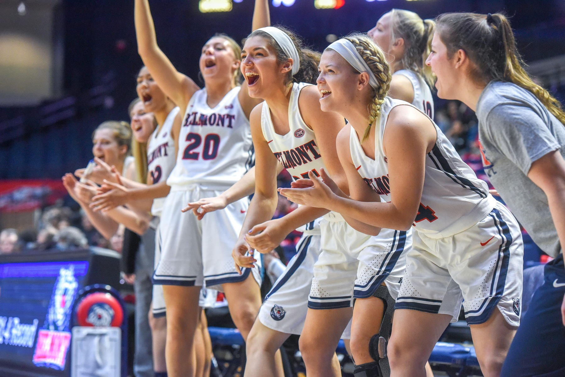 Hannah Harmeyer, second from right, cheers from the bench along side her Belmont women's basketball teammates against Arkansas State earlier this season.