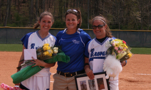 Seniors Katie Thornburg and Beth Brooker along with Coach Stubbs celebrate Senior Day