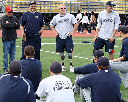 Members of the Wounded Warrior Amputee Softball Team speak to Gallaudet baseball team