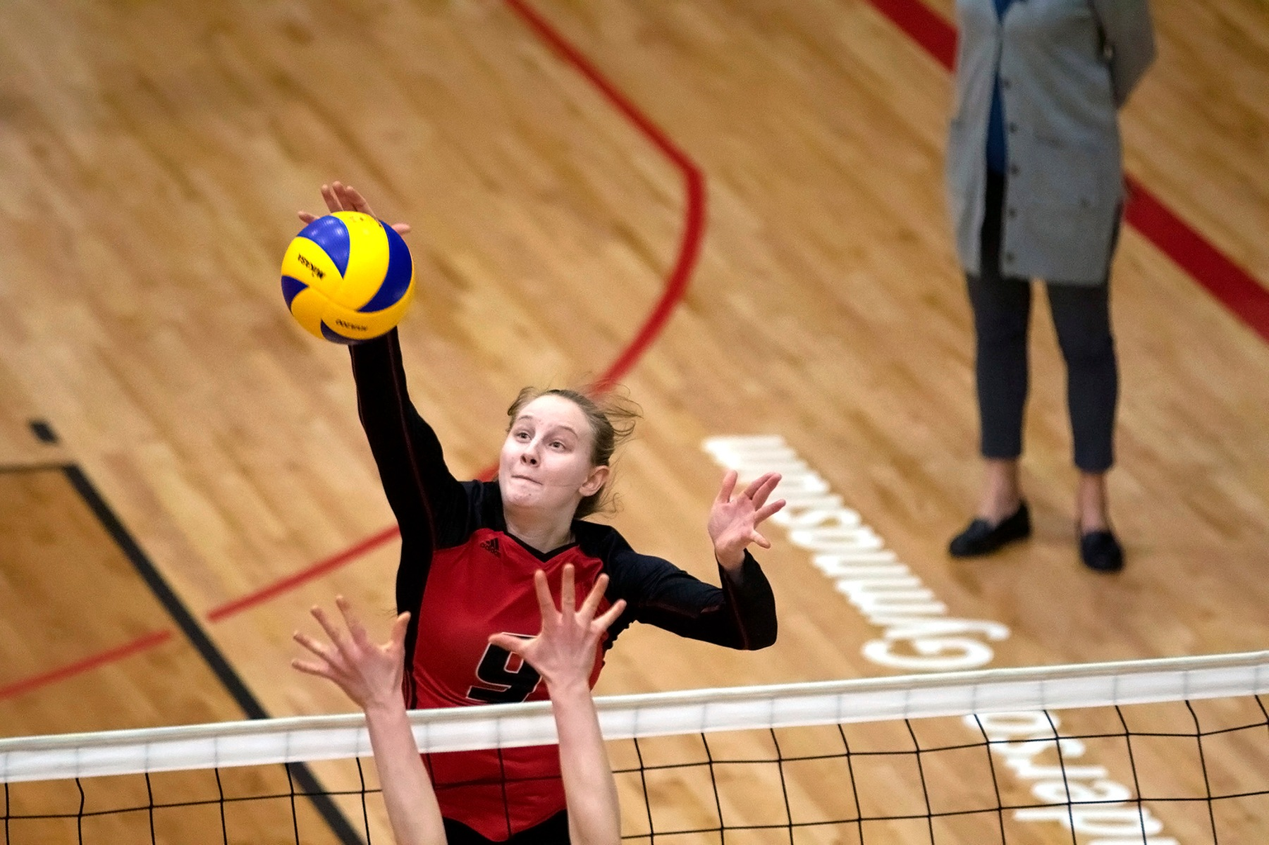 Wesmen left side Emma Parker swings against the Alberta Pandas during Canada West women's volleyball action, Friday, February 15, 2019. (David Larkins/Wesmen Athletics)
