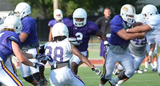 "Golden Eagle football team ""spirited yet poised"" on first day in pads"
