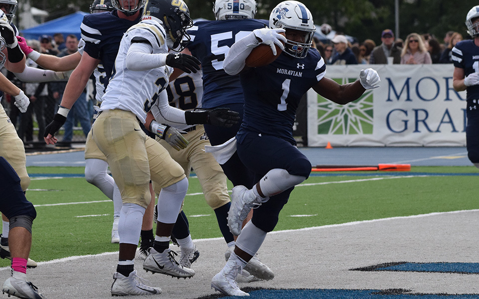 Senior Eli Redmond gets into the end zone against Juniata College on Homecoming shortly after becoming the 11th player in school history to reach 2,000 career rushing yards.