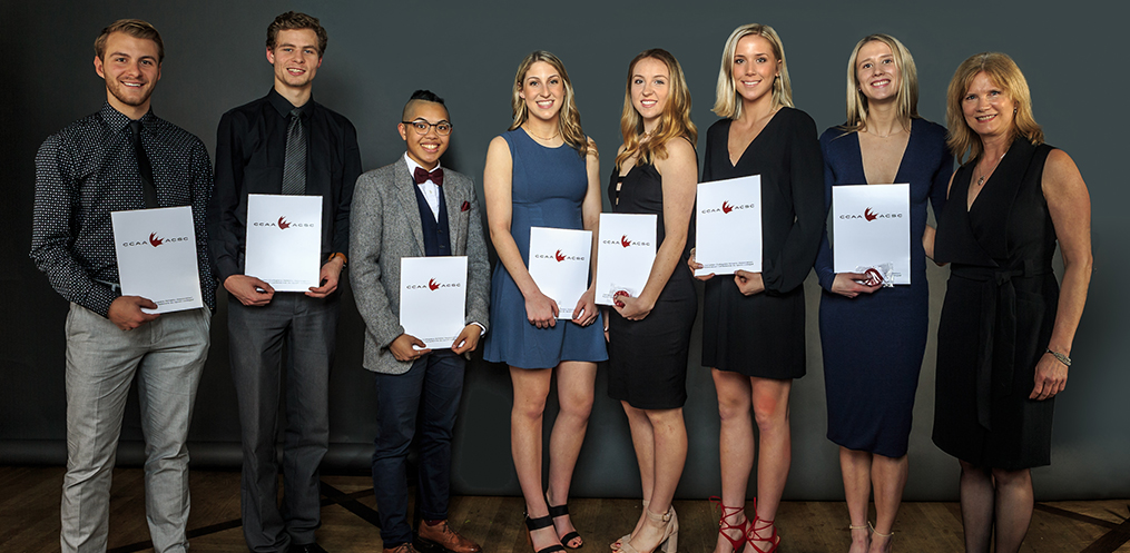 Academic All-Canadians (L-R): Devan Woolley, Keith Jackson, Ashley De La Cruz Yip, Sherrie Errico, Taylor Einhorn, Sarah Hughes, Tyneille Neufeld. Presented by Susan Bush, IT Services Manager, Project Management Office.