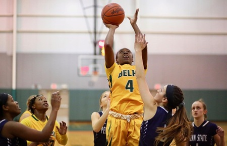 SUNY Delhi's Camryn McDonald goes up for a shot while PSU Hazleton's Sam Varela defends.