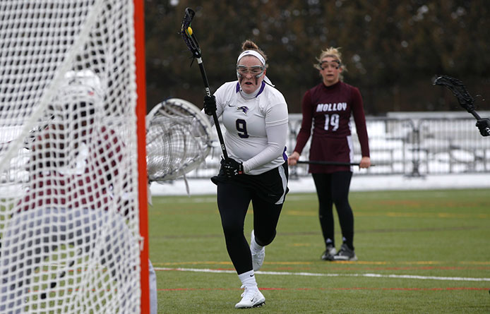Moyna Passes 100-Point Milestone, Women's Lacrosse Falls Late to Southern Connecticut State