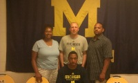 Eric Murphy with parents Akeya and Eric and Coach Mackson