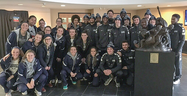 Greyhound Basketball Teams Spend Winter Break Giving Back