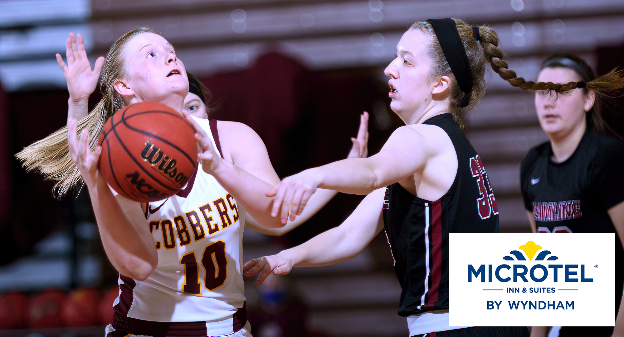 Senior Elizabeth Birkemeyer drives to the basket during the second half of the Cobbers' game with Hamline. She finished with a career-high 21 points on the night.