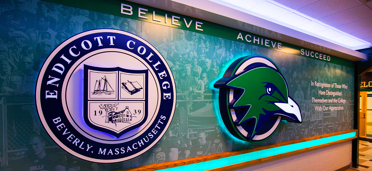 Photo of a wall with Endicott logos on it.