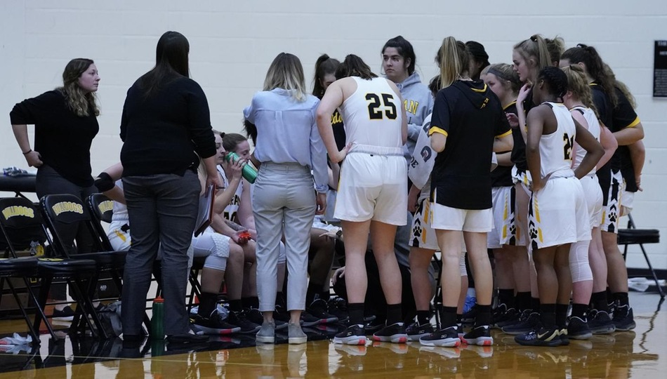 The Adrian Bulldogs women's basketball team during a timeout. (Action photo by Mike Dickie)