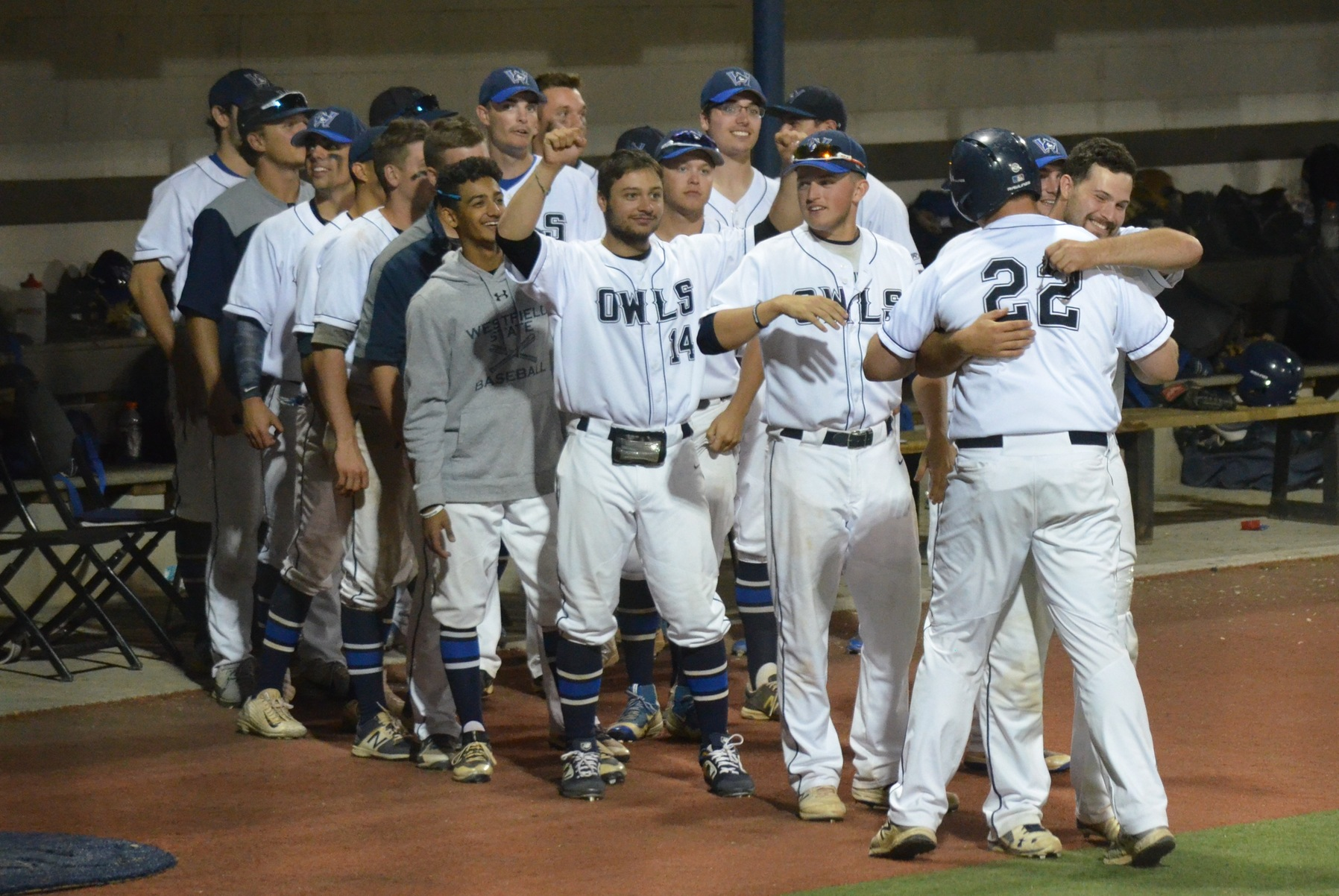 Westfield State senior pitcher John Gegetskas (22) gets a hug from Jake Gibb and is cheered by his teammates after being lifted for a pinch runner after Gegetskas walked in his only career plate appearance in the ninth inning against Shenandoah in the NCAA Tournament.