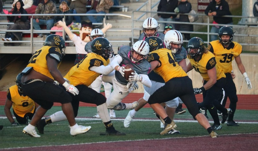 Football Falls to Adrian in Tight Game