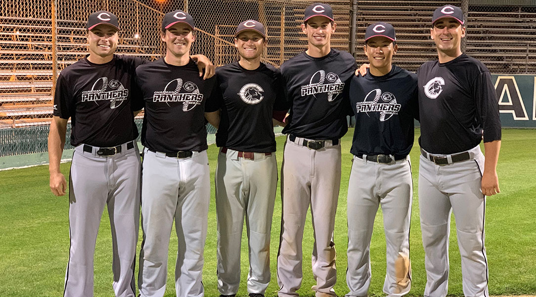 The seniors on the baseball team pose for a photo.