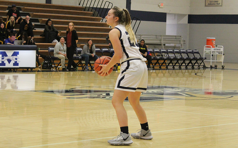 Freshman guard Jackie Kelly sets up the offense in the second half versus Goucher College in Johnston Hall.