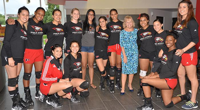 The Eagles pose with President Eileen Holden before tonight's win over South Florida. (Photo by Tom Hagerty, Polk State.)