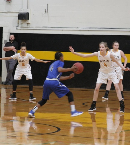 SUNY Broome women's basketball players defending their basket