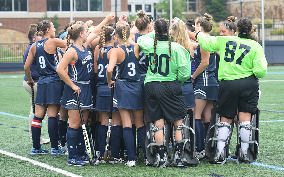 The Greyhound huddle before a match versus Ramapo College of New Jersey this season.