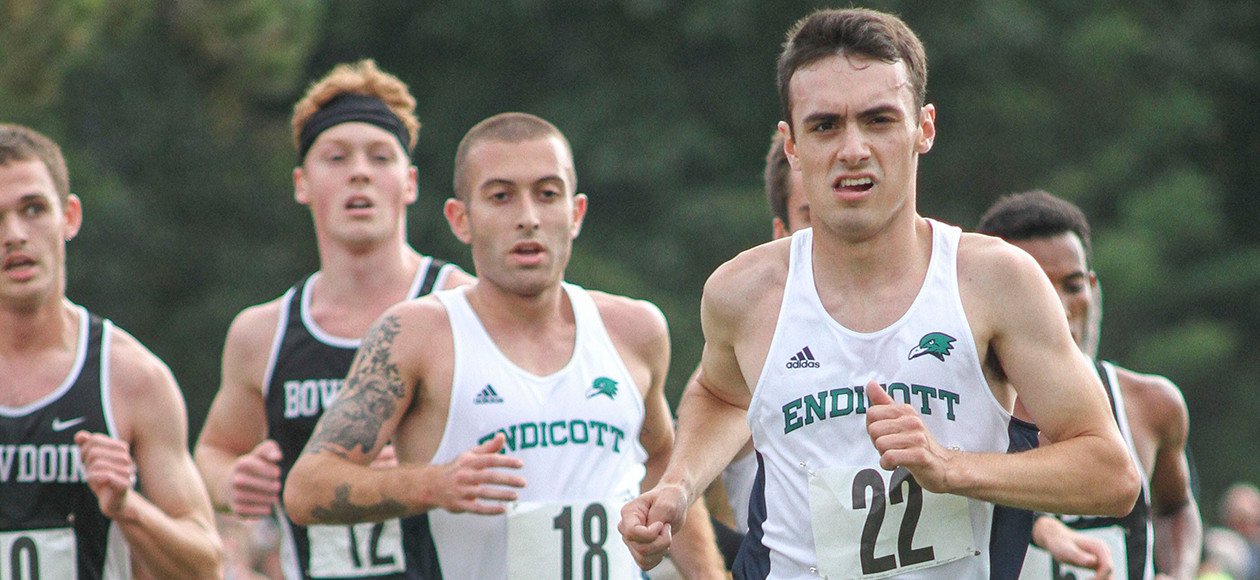 Zach Marshall and Patrick Finocchiaro lead a pack during a cross country race.