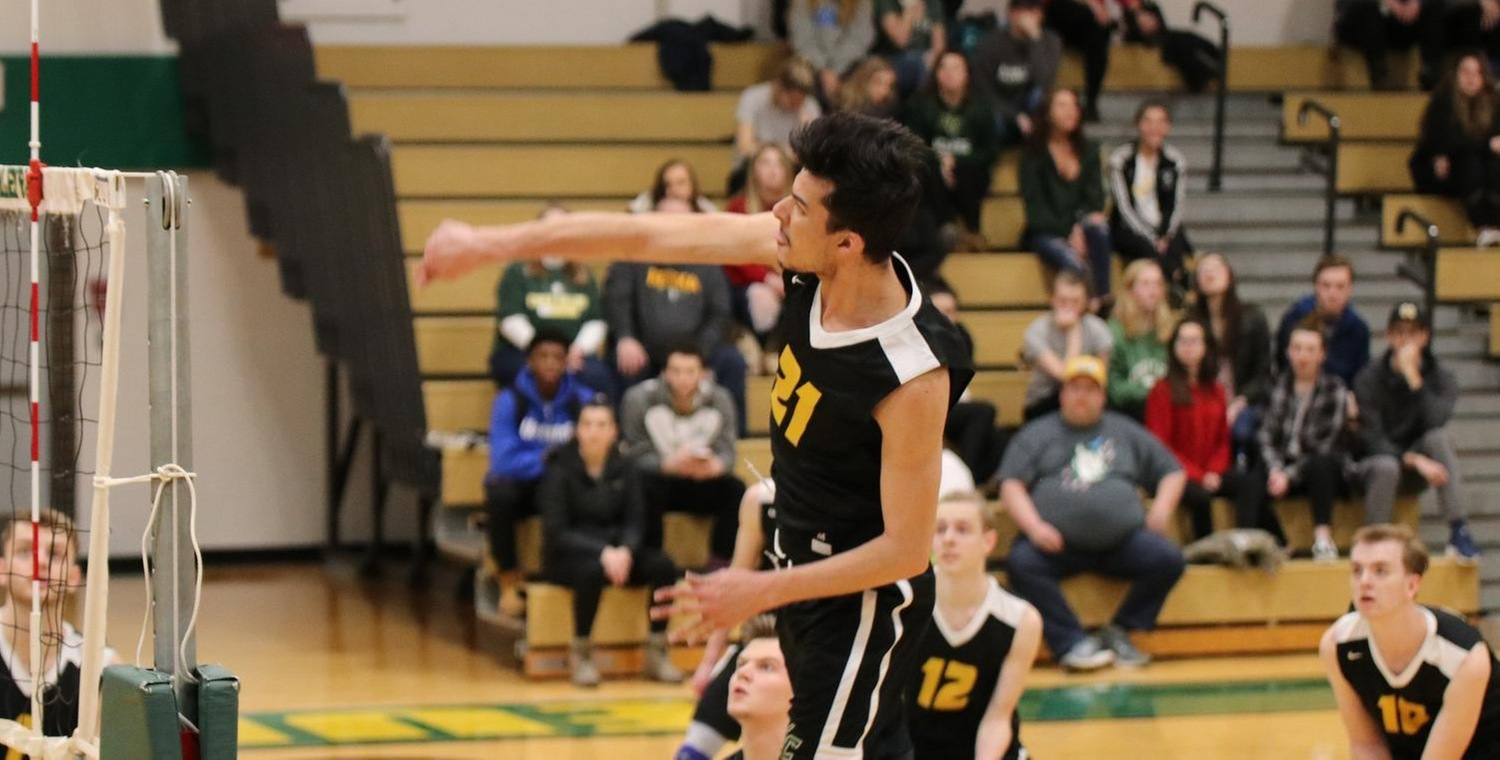 JP Nery (21) led the Wolves with 8 kills on Wednesday -- Photo by Courtney Gleichauf