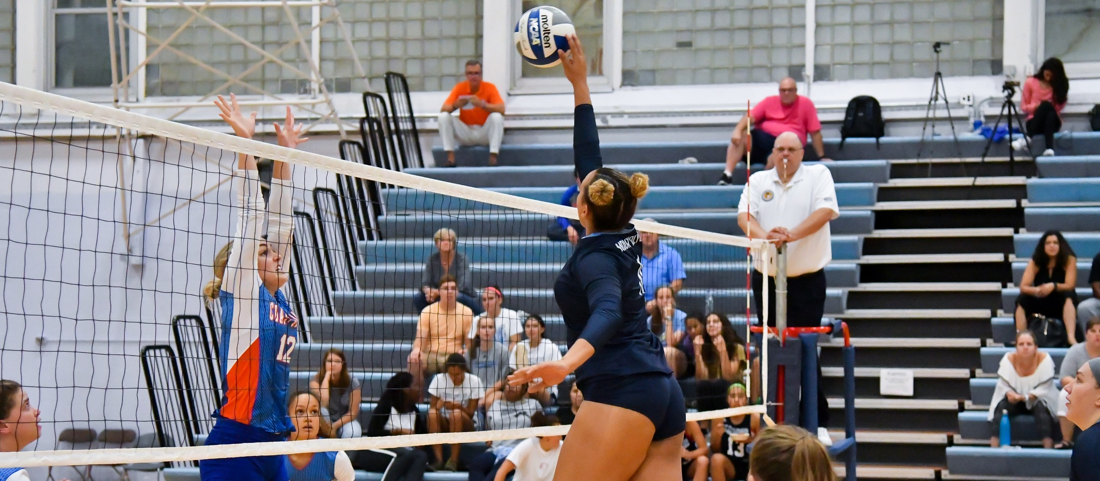 Action photo of volleyball player, Jamesa Allen