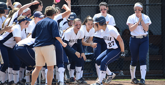 The Greyhounds celebrate Brooke Wehr's first inning home run in the opening game versus The University of Scranton at Blue & Grey Field.