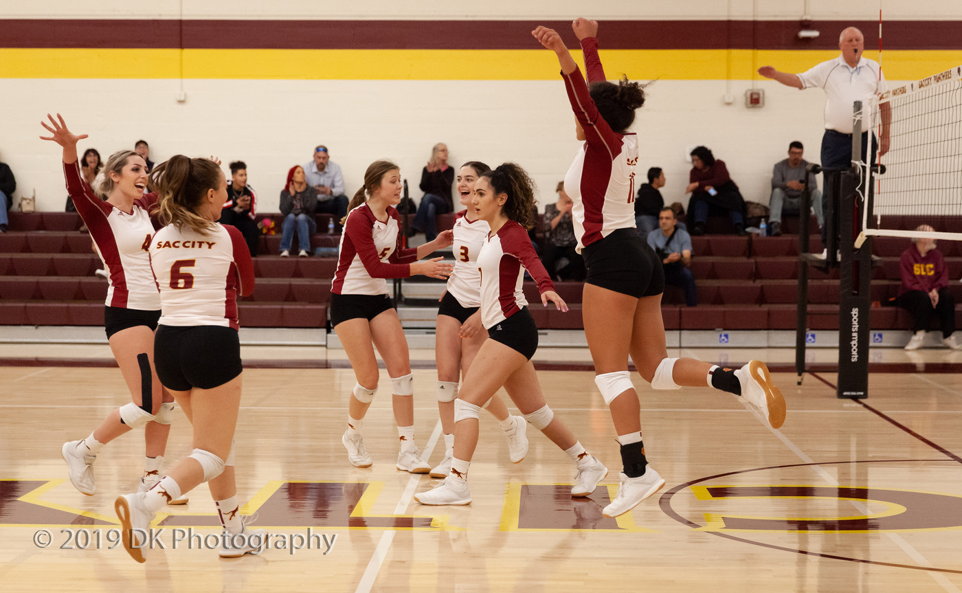 City College volleyball team reacts after winning the point in the match against Sierra College at the North Gym on Oct. 9th.
