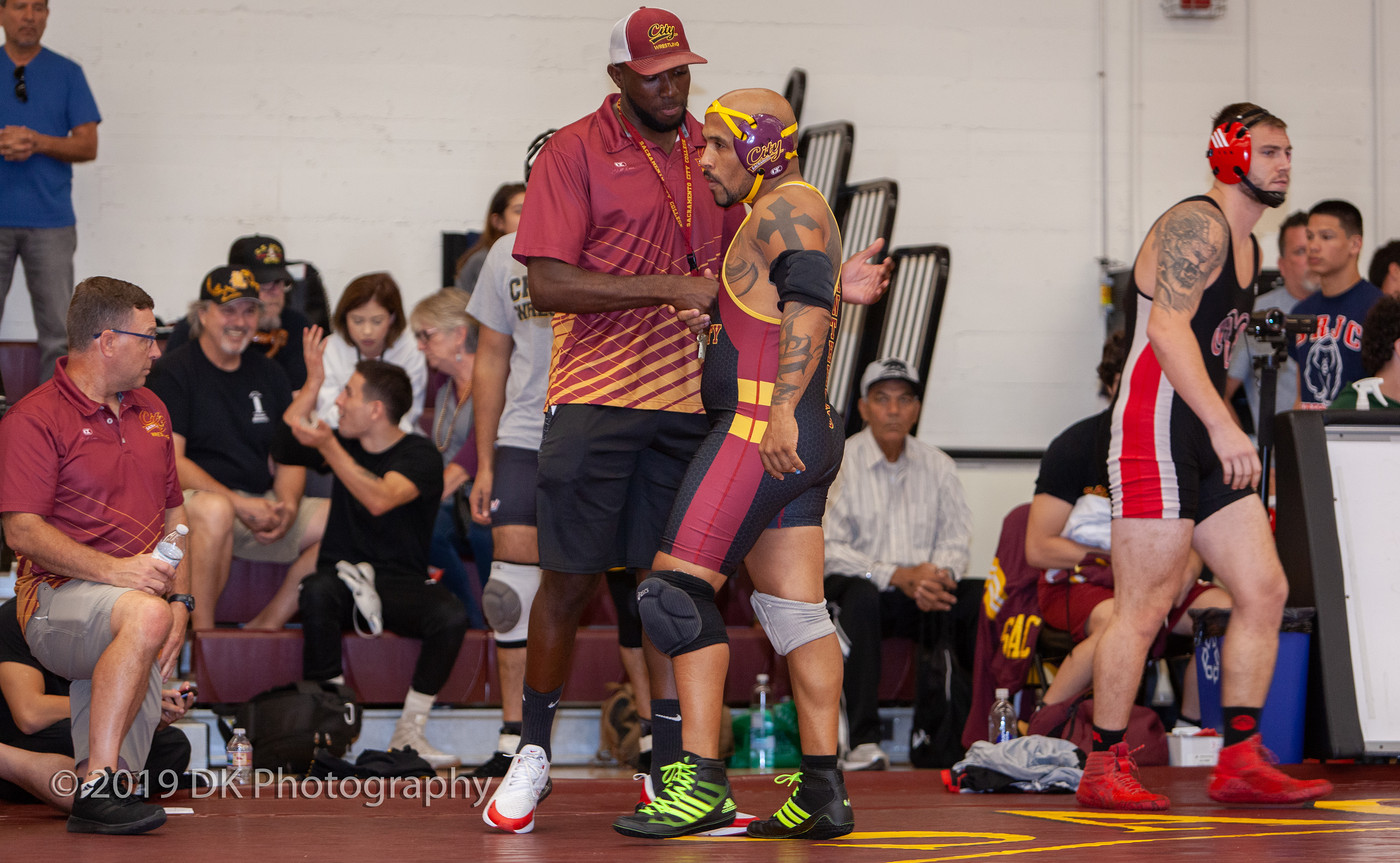 Marques  Gales, City College head coach talks to Edward Jensen-Machey before his first match at the Sac City Invite in the North Gym on Sept. 21st.