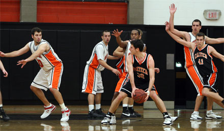 L to R: Joe Sasich, Huston Conti, Gemayal McBride and Sean Anderson play defense against Caltech. (Photo: Tracy Maple)