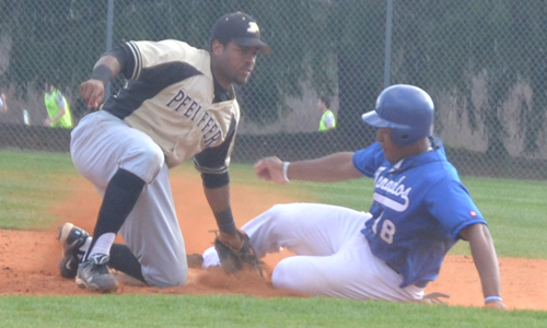 Tarron Robinson slides in ahead of the tag. Photo taken by Bree McMahon.