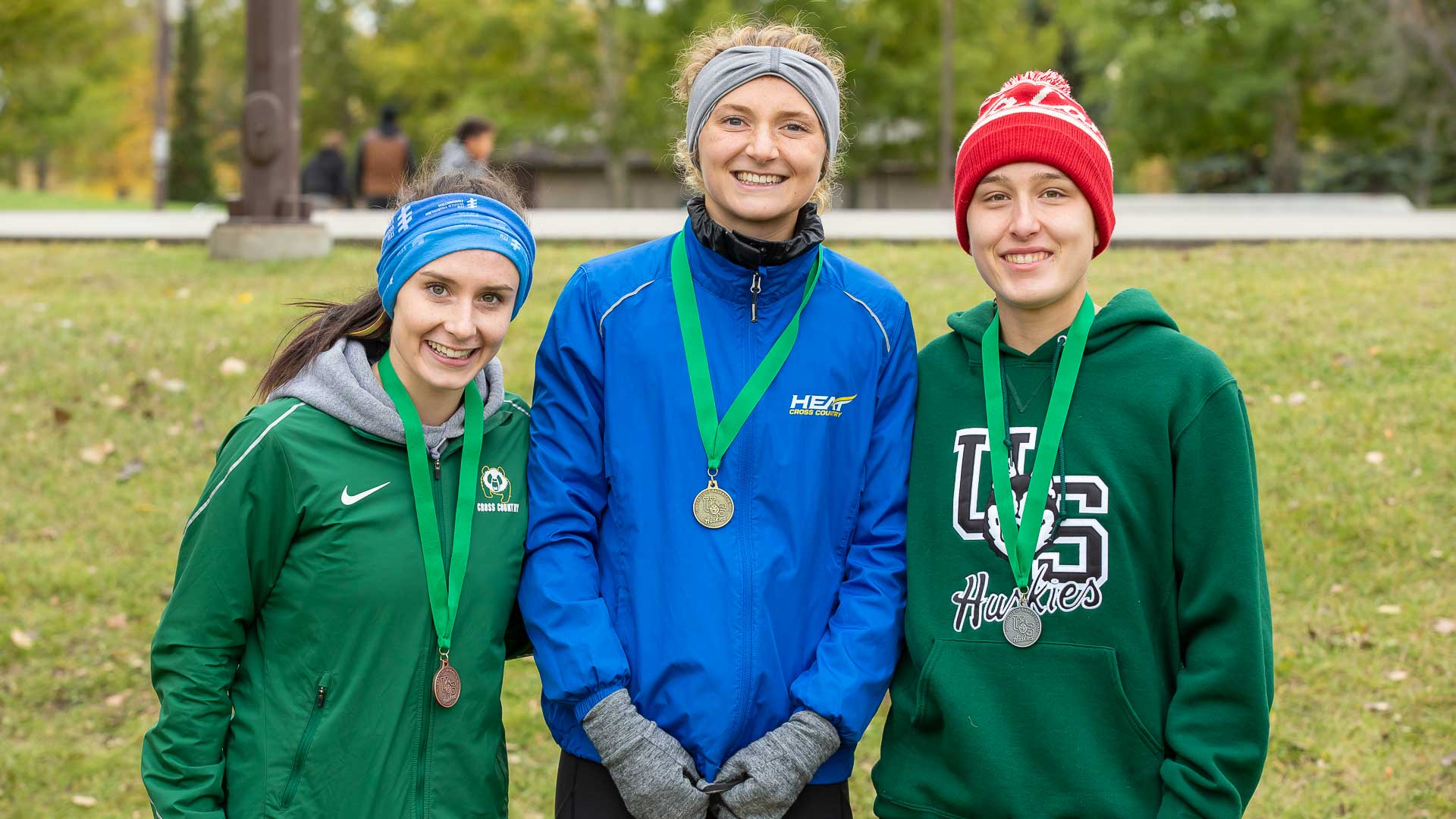 Camille Galloway (centre) with her gold medal. (GetMyPhoto.ca)