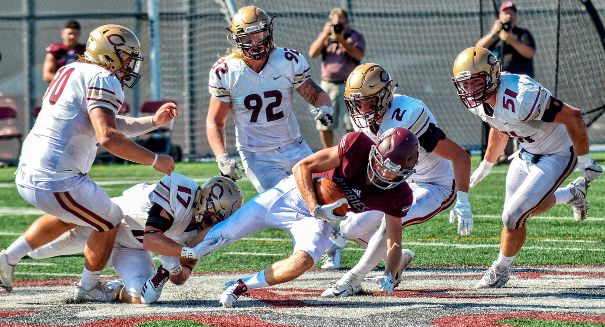 The Cobber defense swarms the Augsburg ball carrier during Concordia's 54-7 win. (Photo courtesy of BJ Pickard - MIAC Office)