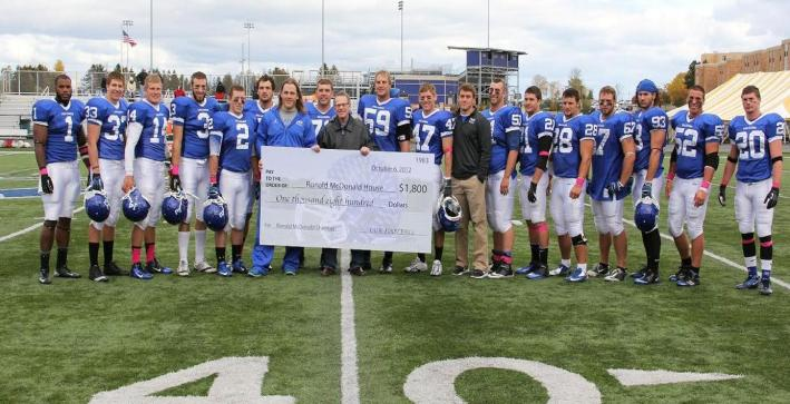 Football donates $1,800 to Ronald McDonald House