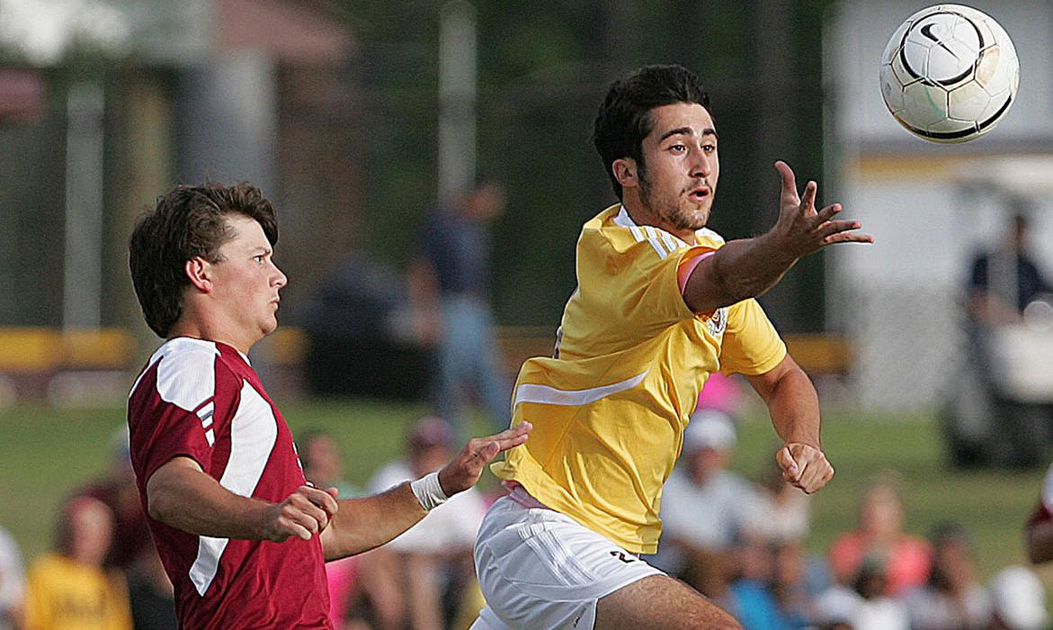Michael Allizzo wears Pearl River's career golden boot