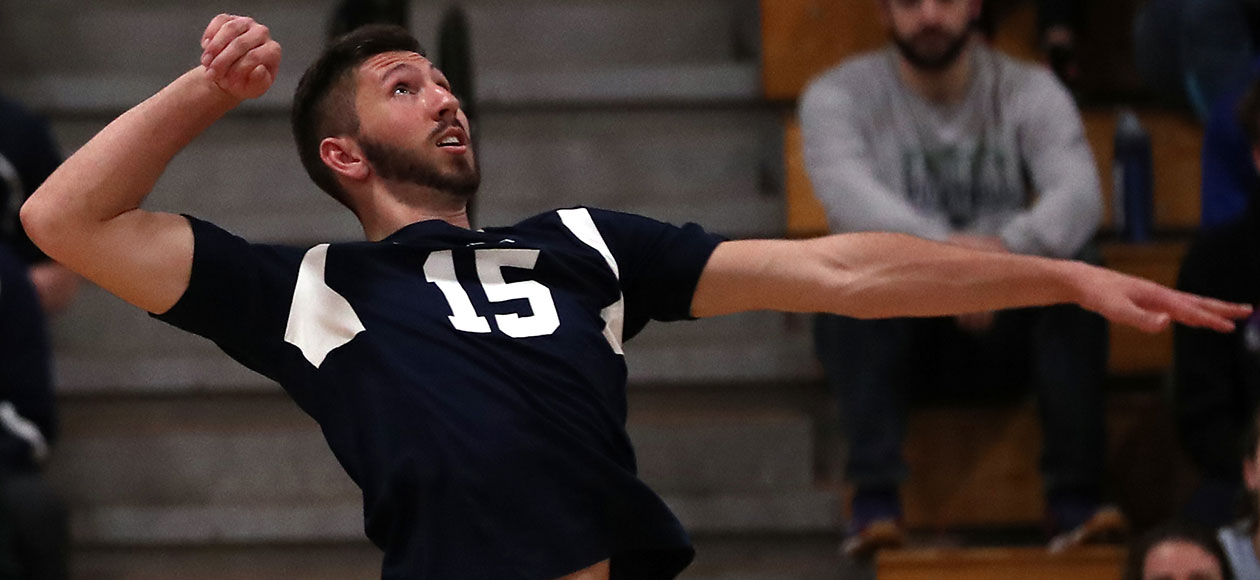 Seth Braquet swings at a volleyball.