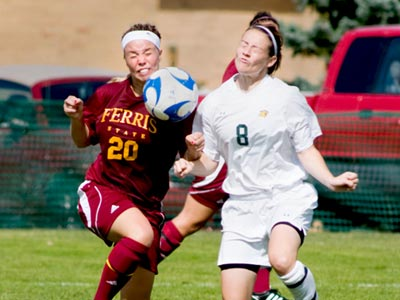 Sam Harrington and Northern Michigan's Dana Stephens collide in pursuit of the ball during Sunday's action.