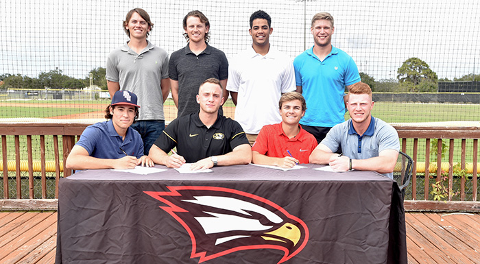 Signing letters of intent are, back row from left: Chad Tworek, Justin Tworek, Isaiah Cullum, Zach Biermann. Front row from left: Zach Schneider, Zach Diewert, Justin Gill, Cole Warken. (Photo by Tom Hagerty, Polk State.)