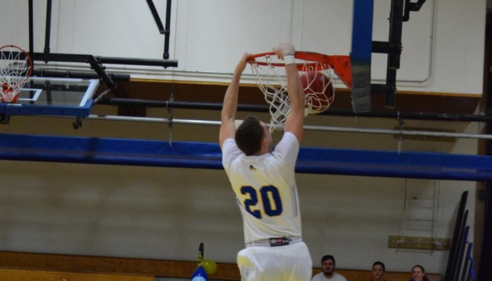 Robbie Adams closes the game with a dunk