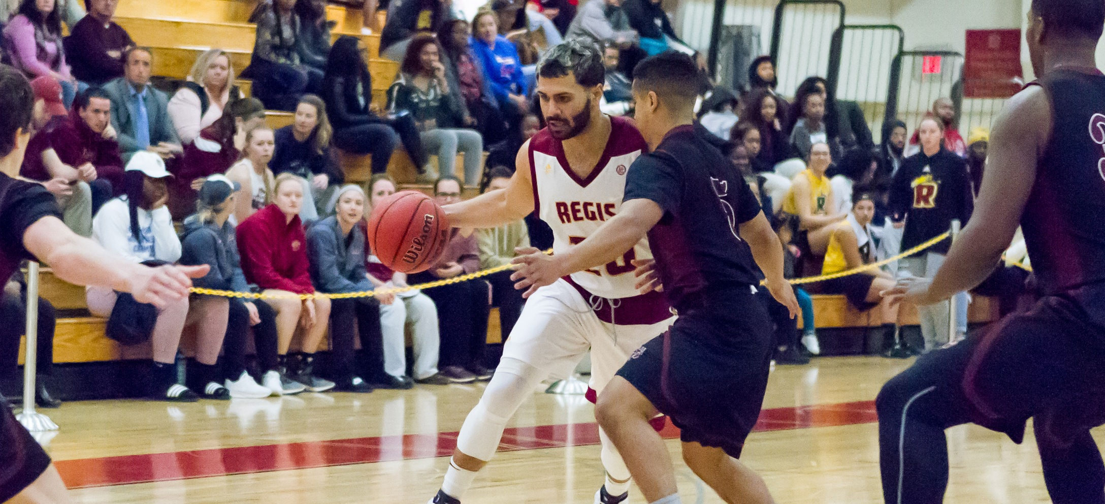 Men's Basketball Rallies For Key Road Win At Suffolk