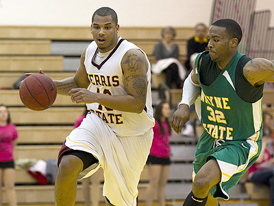 Ferris State's Justin Keenan handles the ball as the Bulldogs take on Wayne State (Photo by Ben Amato)